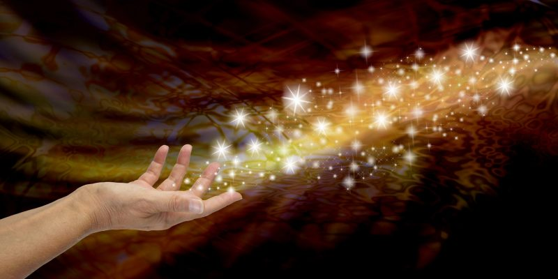 Hand with energy in universe